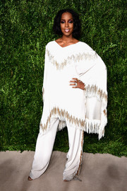 Kelly Rowland attended the CFDA/Vogue Fashion Fund Awards wearing a loose fringed top by Baja East.