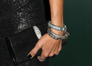 Lisa Edelstein paired her sequin dress and matching clutch with loads of dazzling bangles.