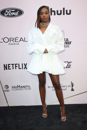 Kiki Layne styled her frock with silver ankle-strap heels.