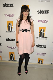 Zooey finishes off this doll-like look with bow accented black pumps.