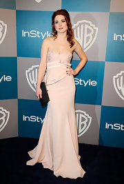 Alexandra Breckenridge wore a pale strapless evening dress to the Golden Globes after-party.