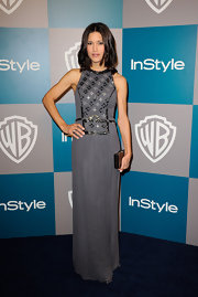 Julia Jones matched the pewter beading of her column dress with a mirrored clutch.
