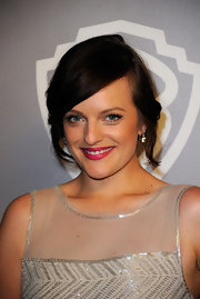 Elisabeth Moss wore a flirty pair of false lashes and shimmering metallic silver shadow at a Golden Globe Awards after party.