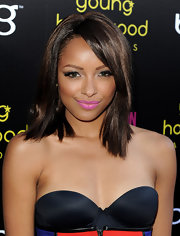 Kat Graham debuted a shoulder length cut at the 13th Annual Young Hollywood Awards. She parted her tresses down the side and swept them across her face.