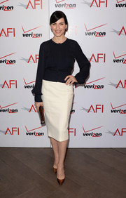Julianna Margulies styled her outfit with bronze pointy pumps by Christian Louboutin.