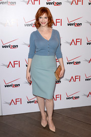 Christina Hendricks teamed her cardigan with a Dolce & Gabbana pencil skirt in a lighter shade of blue.