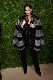 Nicole Trunfio made a stylish arrival at the CFDA/Vogue Fashion Fund Awards wearing a gray and black striped fur coat by RtA.