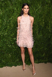 Champagne satin pumps polished off Sara Sampaio's sweet look.