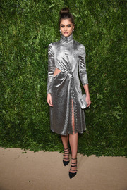 A metallic silver clutch topped off Taylor Hill's ensemble.