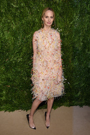Lauren Santo Domingo got fancied up in a feather-festooned cocktail dress by Calvin Klein for the CFDA/Vogue Fashion Fund Awards.