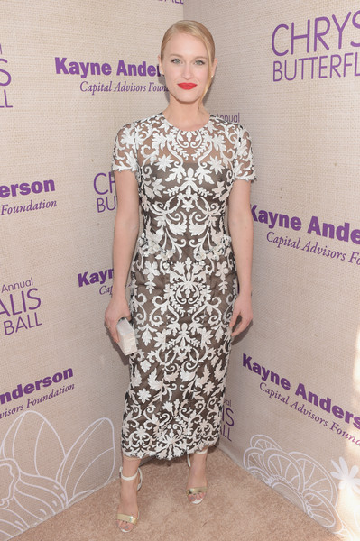 A pair of gold and white ankle-strap sandals finished off Leven Rambin's look.
