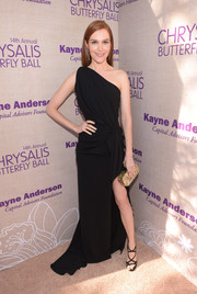 Darby Stanchfield injected some glitter via a metallic gold clutch.