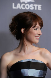 Ellie Kemper wore her tresses wound into a casual updo with romantic loose strands and softly side-swept bangs at the 14th Annual Costume Designers Guild Awards.