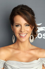 Kate Beckinsale attended the 14th Annual Costume Designers Guild Awards wearing her hair in a romantic updo featuring a loose multi-braid bun.
