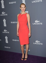 Amber Valletta wore this lovely peach cocktail dress to the Costume Designers Guild Awards.