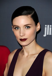Rooney Mara completed her look with a sweep of bold burgundy lipstick for the 14th Annual Costume Designers Guild Awards.