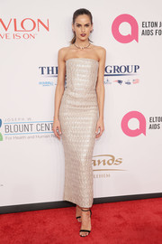 Izabel Goulart looked supremely elegant in a textured ivory strapless dress by Armani at the Enduring Vision benefit.