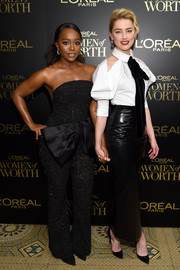 Amber Heard paired a black patent maxi skirt with a white cold-shoulder blouse, both by Ralph & Russo, for the 2019 L'Oreal Paris Women of Worth Awards.