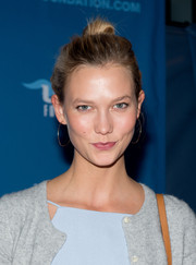 Karlie Kloss complemented her updo with a pair of thin gold hoops.