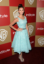 Nina Dobrev looked ultra-flirty and feminine in this baby blue appliqued dress at the Golden Globes after-party.