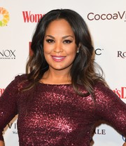 Laila Ali framed her beautiful face with a center-parted wavy hairstyle for the Woman's Day Red Dress Awards.