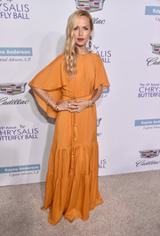 Rachel Zoe was boho-glam (as always) in a caped marigold maxi dress from her own label during the Chrysalis Butterfly Ball.
