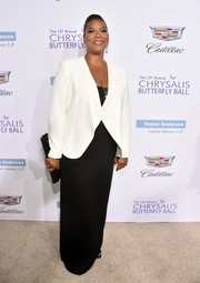 Queen Latifah went for minimalist elegance in a white blazer layered over a black column dress at the Chrysalis Butterfly Ball.