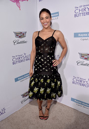 Paula Patton finished off her outfit with chic black ankle-strap sandals.
