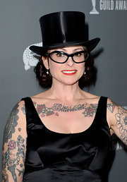 Julie Vogel showed her quirky side with a satin top hat and retro glasses.