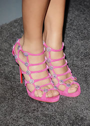 Hot pink strappy sandals with sparkly embellishments added some extra pizass to Ashley Madekwe's red carpet look.