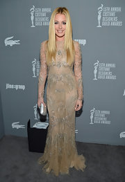 Cat Deeley looked pristinely glamorous in this nude tulle dress with silver beading at the Costume Designers Guild Awards.