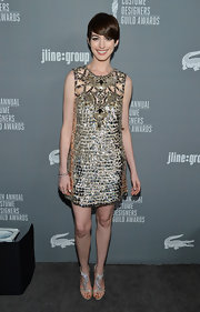 Anne looked like a mod goddess in this gold-emblazoned shift dress at the Costume Designers Guild Awards.