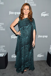 Maya Rudolph draped herself under layers of turquoise print chiffon at the Costume Designers Guild Awards.