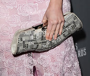 Carly Steel added a modern edge to her pink lace gown with a studded over-sized clutch.