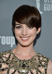 Anne Hathaway's short style looked sleek and shiny at the 2013 Costume Designers Guild Awards.
