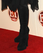 Stevie Nicks paired black knee-high boots with her billowy dress for an edgy-meets-chic look.