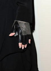 Stevie Nicks amped up the edge factor with chain mail-embellished black fingerless gloves.