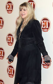 Stevie Nicks looked subdued but stylish in a black cropped jacket over a gauzy dress.