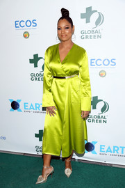 Garcelle Beauvais looked radiant in a chartreuse satin wrap dress at the Global Green pre-Oscars gala.