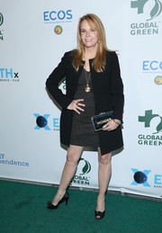Lea Thompson layered a collarless black coat over a gray dress for the Global Green pre-Oscars gala.