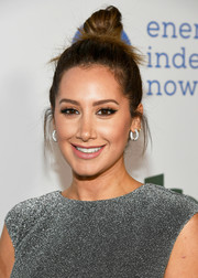 Ashley Tisdale sported a cute top knot at the Global Green pre-Oscars party.