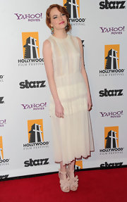 Emma Stone paired her cream tea-length frock with T-strap platform sandals complete with bow detailing.
