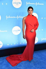 Priyanka Chopra looked super sophisticated in a one-sleeve red fishtail gown by Ferragamo at the 2019 UNICEF Snowflake Ball.