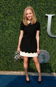 Amanda Seyfried added a touch of print with a Givenchy floral clutch.