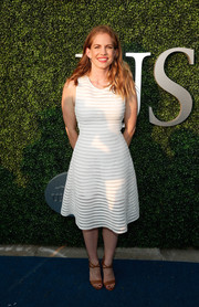 Tan sandals with crisscross ankle straps finished off Anna Chlumsky's look.