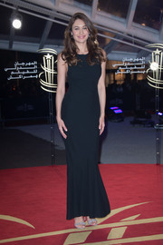 Olga Kurylenko was minimalist-elegant in a midnight-blue evening dress with a fluted hem on day 7 of the Marrakech International Film Festival.