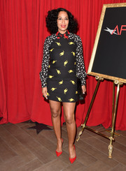 Tracee Ellis Ross completed her fun look with pointed red heels.