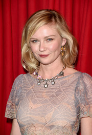 Kirsten Dunst rocked a short wavy cut to frame her face at the AFI Awards.
