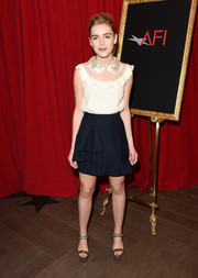 Kiernan Shipka looked polished in a colorblocked cream and navy dress with an embroidered collar at the AFI Awards.