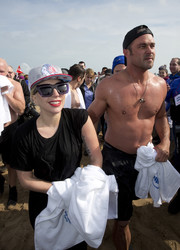 Lady Gaga accessorized with thick-framed angular shades while participating at the Chicago Polar Plunge.